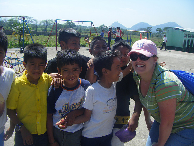 Briana with group of kids on playground guatemala